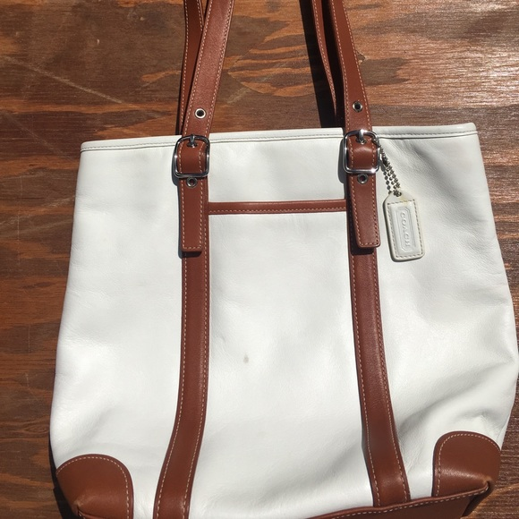 Coach handbag and wristlet set. White brown